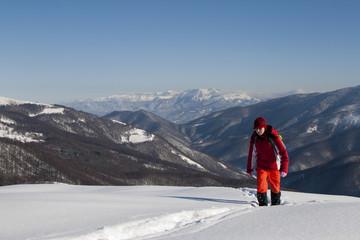 Woman climbing mountains in winter