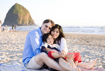 Small family with disabled little boy at the beach