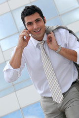 Smiling executive talking on a cellphone