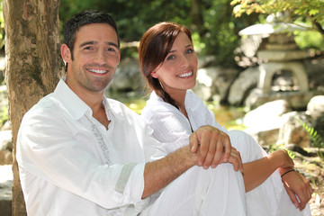 Couple in white in a oriental stone garden