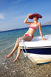 Woman in bikini on boat in Greece