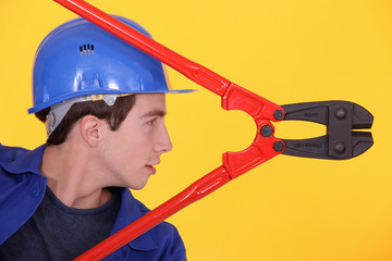 Young man with boltcutters