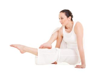 Young woman doing yoga exercise