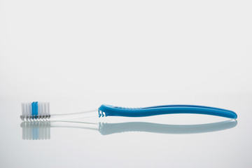 Toothbrush lying on glass shelf