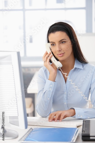 Office girl on landline call