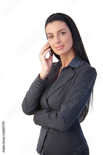Confident businesswoman on phone