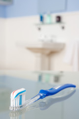 Toothbrush with toothpaste in bathroom