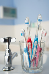 Toothbrushes in bathroom
