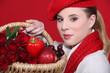 Woman holding winter fruit basket