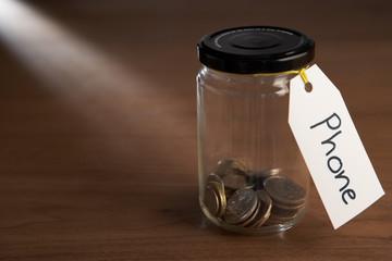 Coins in a jam jar