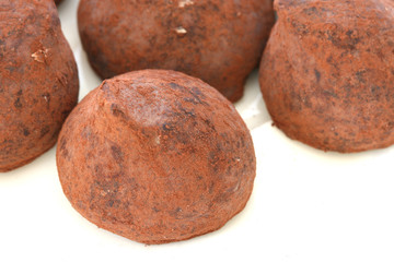Chocolate truffle pralines sweets covered in cocoa powder