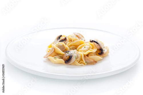Tortellini dish with sauteed mushrooms and garlic