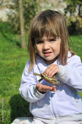 beautiful little girl with the turtle