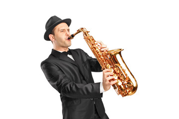 Young man wearing hat and playing on saxophone