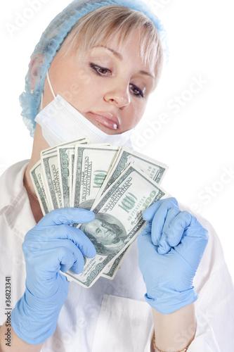 Doctor holding money on isolated background