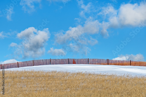 Protective Snow Fence in Field