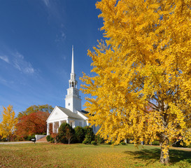 church with fall foliage