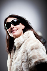 Woman wearing winter clothes and sunglasses