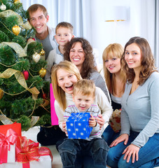 Happy Big family holding Christmas presents at home