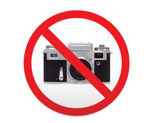 Sign prohibiting the use of cameras and photography.