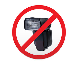 Sign prohibiting use of photoflash.