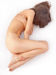naked woman lying in a fetal position