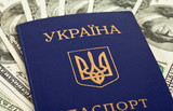 Ukrainian passport on US dollars background