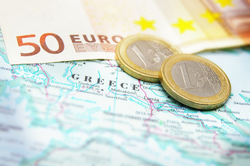 Closeup of Euro coins on a map of Greece