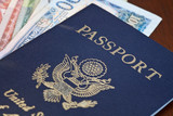 Macro shot of passport and foreign currency poster