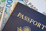 Macro shot of passport and foreign currency with boarding pass poster