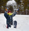 Happy child playing with snow