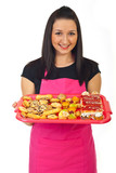 Confectioner female offering cakes
