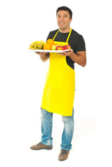 Full length of market worker with fruits