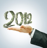 2012 sign on businessman's hand