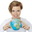 Young woman holding a globe in her hands