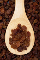 Raisins on wooden spoon