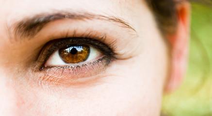 A smiling girl's eye