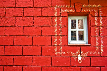 Window on a red wall