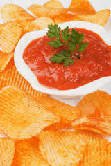 Potato chips and salsa dip
