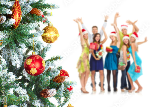 Happy people near Christmas Tree.