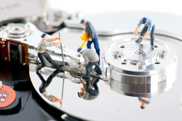 Group of workers repair hard drive