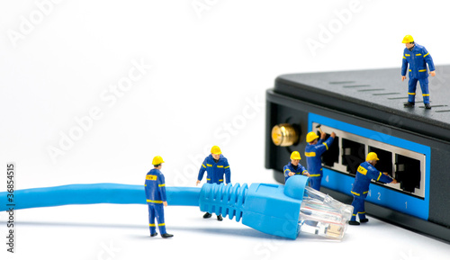 Technicians connecting network cable - 36854515