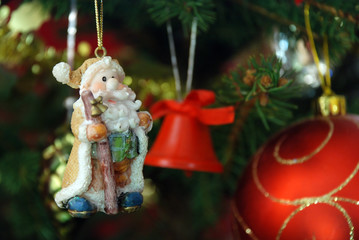 Santa Claus toy on the decorated Christmas fir tree