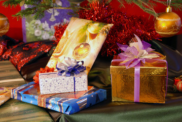 Christmas gifts under the decorated Christmas fir tree
