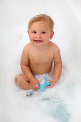 Cute toddler in the bath tub