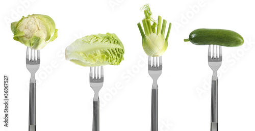 fresh green baby vegetables on forks