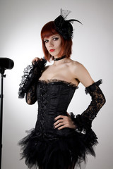 Attractive woman in black corset and tutu skirt