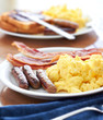 sausage links with scrambled eggs and bacon