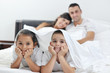 happy young Family in their bedroom