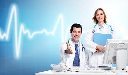 Group of medical doctors over cardio background.